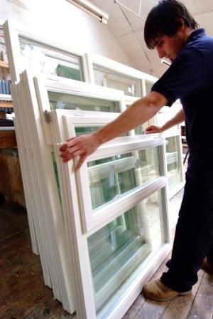 Warehouse team manufacturing windows